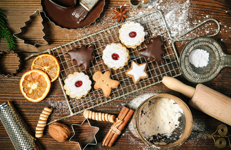 baking: Christmas baking background with cookies, cookie cutters, spices and other ingredients