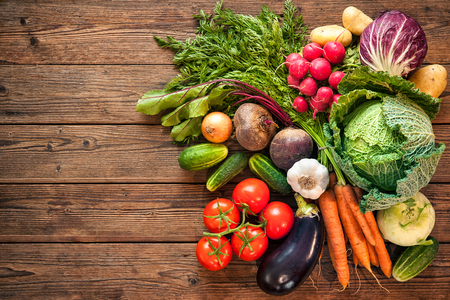 Assortment of the fresh vegetables on wooden background Фото со стока - 61925582