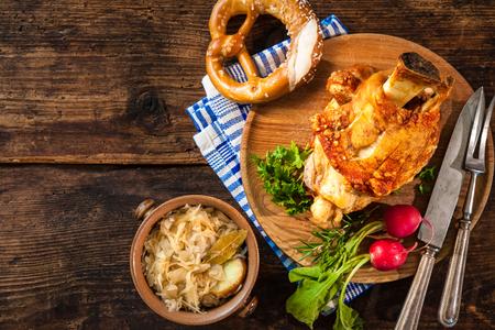 wiesn: Appetizing Bavarian grilled pork knuckle with sauerkraut. Oktoberfest