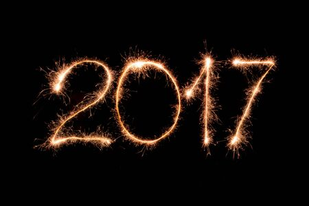 turn of the year: 2017 text made from sparkler firework light