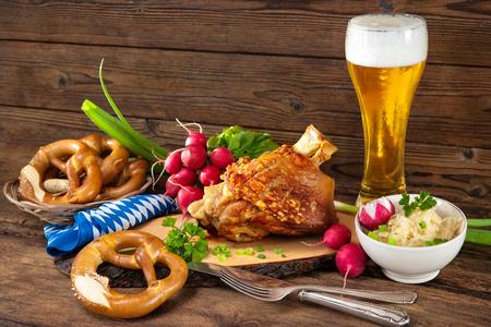 pretzel: Pork knuckle with beer and sauerkraut. Oktoberfest Stock Photo