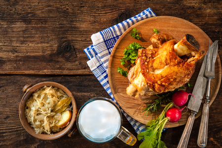Pork knuckle with beer and sauerkraut. Oktoberfest Stock Photo