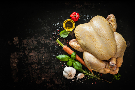 black breast: Raw chicken with vegetables, oil and spices on the slate background Stock Photo