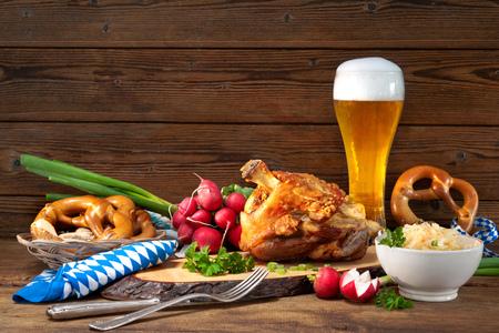 Pork knuckle with beer and sauerkraut. Oktoberfest Фото со стока