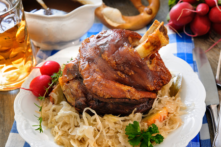 pork: Appetizing Bavarian grilled pork knuckle with sauerkraut. Oktoberfest