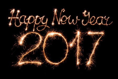 fonts year: Happy new year 2017 text made from sparklers firework light