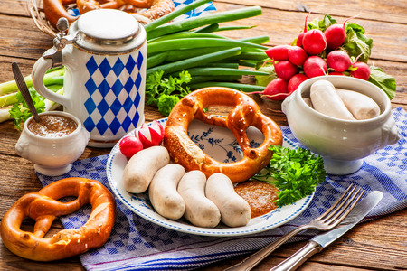 weisswurst: Traditional Bavarian meal. White sausages with sweet mustard and pretzel Stock Photo