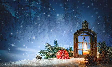 Burning lantern in the snow. Christmas background