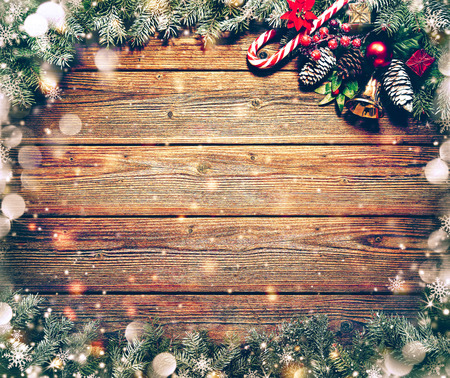 shiny gold: Christmas background with fir tree and decoration on dark wooden board