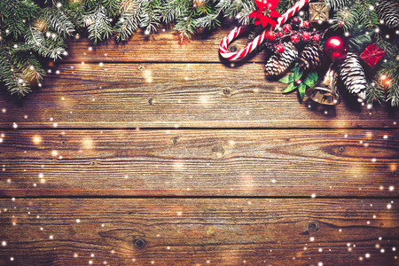 Christmas background with fir tree and decoration on dark wooden board Reklamní fotografie - 68805612