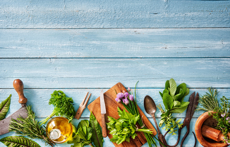 fresh kitchen herbs and spices on wooden table. Top view Stock Photo