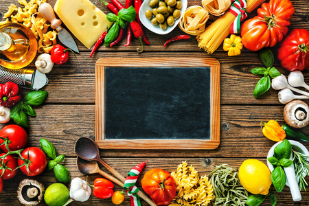 cooking oil: Italian cuisine. Vegetables, oil, spices and pasta on the wooden table