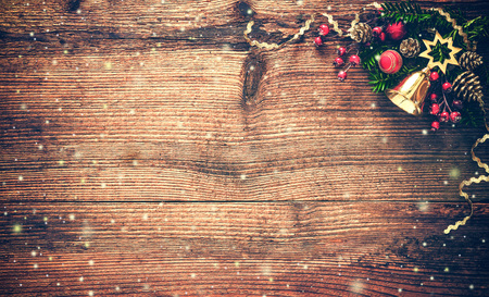 grunge backgrounds: Christmas background with fir tree and decoration on dark wooden board