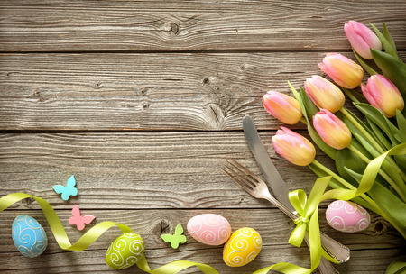 Easter table setting with spring tulips and cutlery. Holidays background