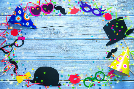 fasching: Colorful background with carnival booth props, streamers and confetti
