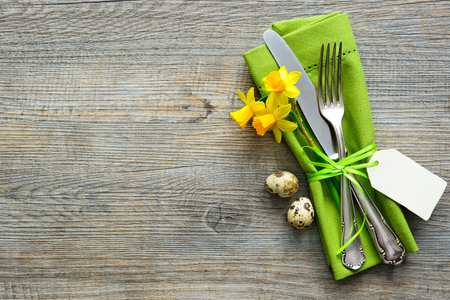 cutlery: Easter table setting with daffodil and cutlery. Holidays background