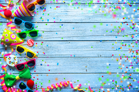 favor: Colorful carnival background with party accessory, streamers and confetti