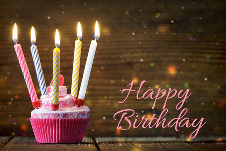 an icing: Birthday cake with burning candles Stock Photo