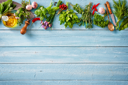 fresh kitchen herbs and spices on wooden table. Top view Фото со стока