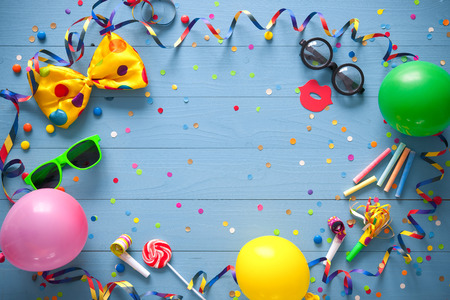 fasching: Colorful birthday frame with party items on blue background. Happy birthday concept