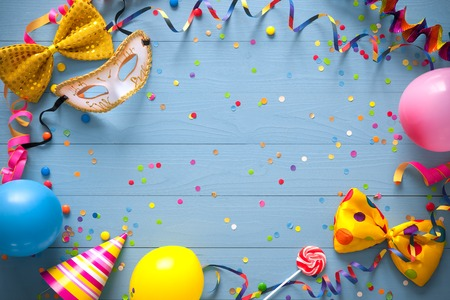Colorful birthday frame with party items on blue background. Happy birthday concept Фото со стока - 70560364