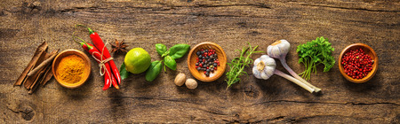 food additives: Various herbs and spices on wooden table
