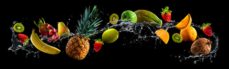 green water: Fruits on black background with water splash