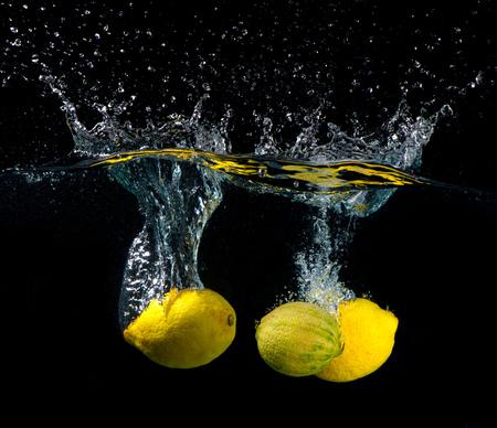 water wave: Lemon splash in water on black background Stock Photo