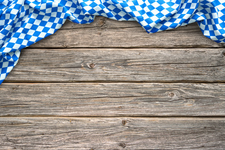 Rustic background for Oktoberfest with bavarian white and blue fabric on wooden Banco de Imagens - 74154727