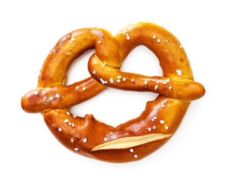 Appetizing Bavarian pretzel isolated on white background Фото со стока