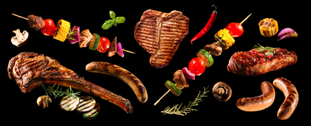 Collage of various grilled meat and vegetables on black background Reklamní fotografie
