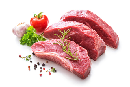 Pieces of raw roast beef meat with ingredients for grilling isolated on white Stock Photo
