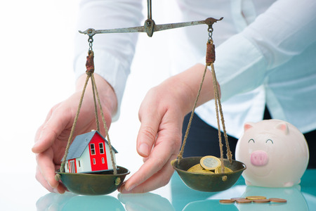 real estate house: Savings or real estate investment concept with house and cash money on scale