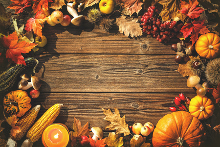 fruit: Vintage autumn border from fallen leaves and fruits on the old wooden table. Thanksgiving autumn background