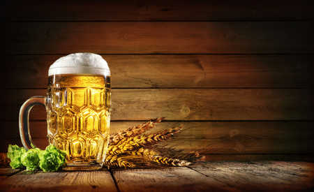 Oktoberfest beer with wheat  and hops on wooden table Zdjęcie Seryjne - 78446421