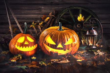dark: Halloween pumpkin head jack lantern with burning candles