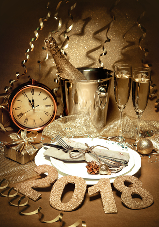 New year holiday table setting with champagne. Celebration. Place setting for new year eve. Holiday decorations. Served table Archivio Fotografico