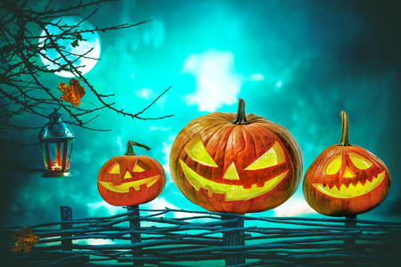 Halloween pumpkins in front of nightly spooky forest background Stock Photo