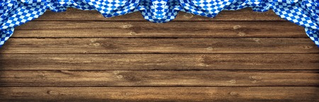 feast: Rustic background for Oktoberfest with Bavarian white and blue fabric on old wooden board