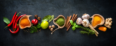 domestic: Various herbs and spices on dark background