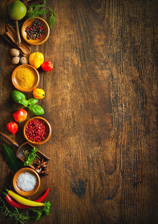 Various herbs and spices on wooden table Stock Photo - 80128894