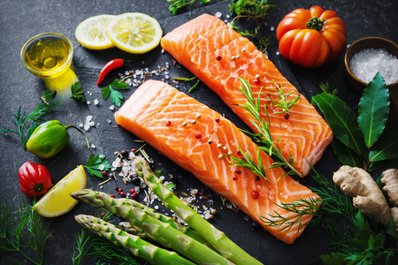 spice: Fresh salmon fillet with aromatic herbs, spices and vegetables. Balanced diet or cooking concept