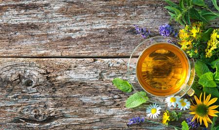 Cup of herbal tea on wooden table Reklamní fotografie