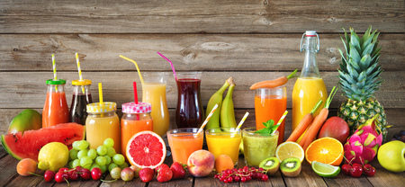 Various freshly squeezed fruits and vegetables juices