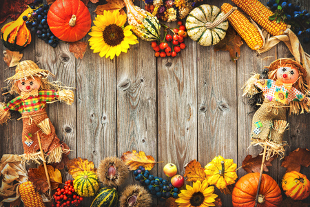 Colorful autumn border with scarecrow decoration for Halloween and Thanksgiving