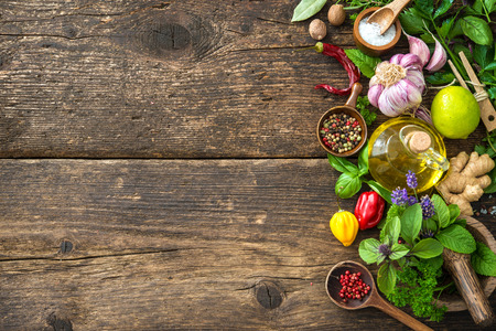 cutting: Fresh herbs and spices on wooden table. Top view with copy space