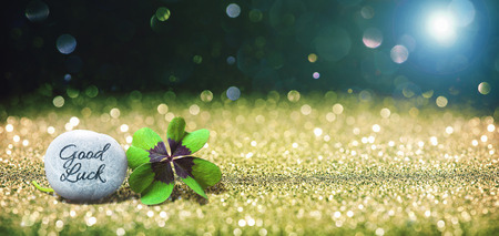 Abstract background with four leaf lucky clover and stone as copy space Foto de archivo