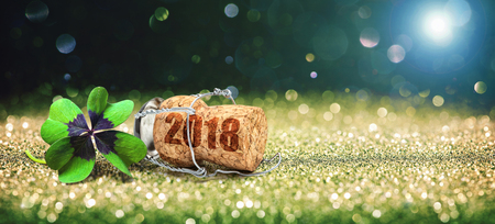 Happy New Year. Greeting card with four leaf clover and champagne cork Banque d'images