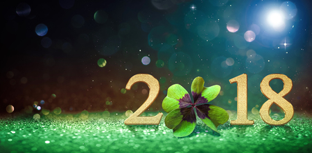 Happy New Year greeting card with four leaf clover and numbers 2018 Stock Photo