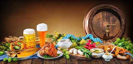 Beer, pretzels and various Bavarian specialties. Oktoberfest background Stock Photo